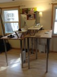 Our two standing desks, customized for proper working height